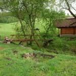 Первые капитальные строения на участке - баня и мост через ручей